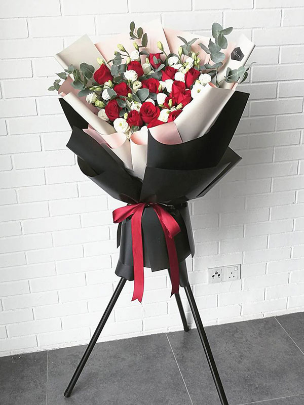red-rose-opening-flower-stand