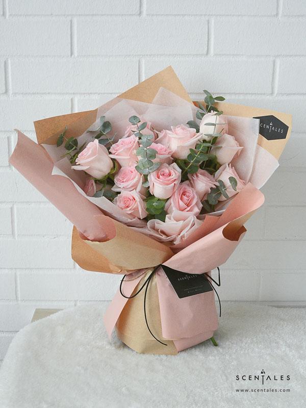 minimalist pink rose crepe pink bown flower bouquet